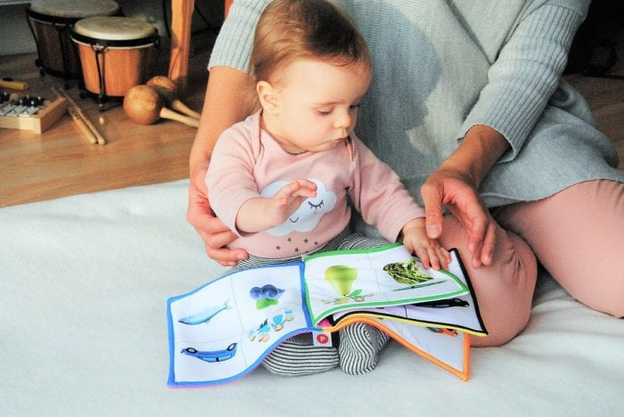 parent reading baby a book