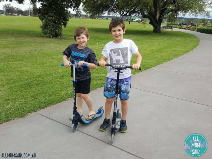 active kids riding scooters