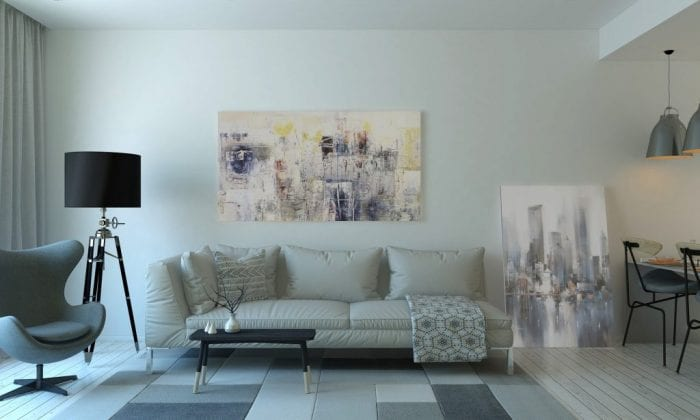 Living room with couch, tripod lamp and chair | affordable interior decorating