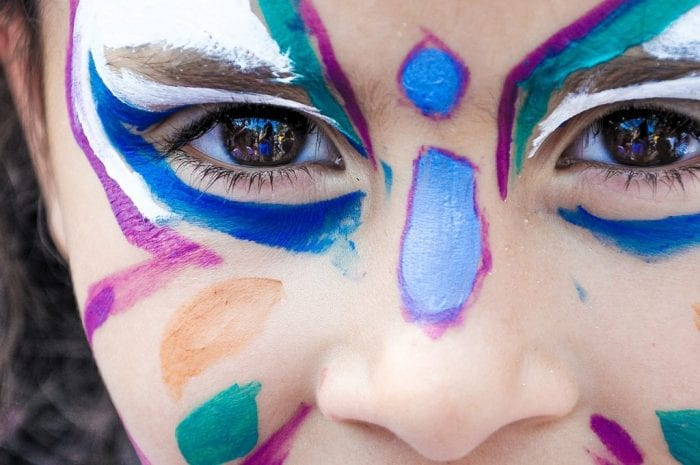 little girl face painting as a butterfly
