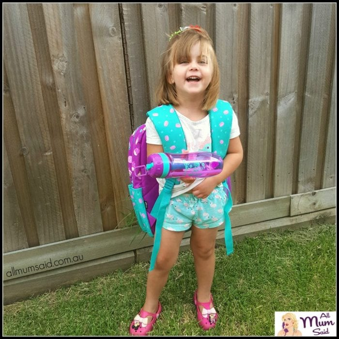 back to school smiggle backpack | preschool girl laughing wearing backpack