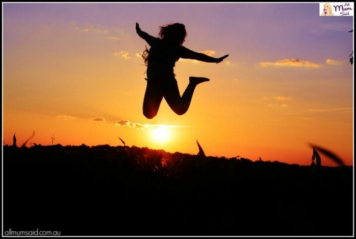 live free lady jumping high in the air with sunset | word for 2017