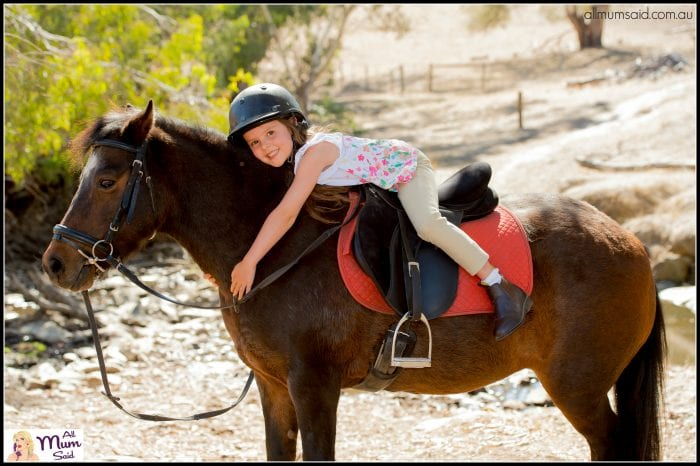 horse riding Hunter Valley | girl hugging a brown horse