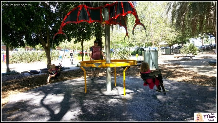 kids playing on carousel swing at Maitland Park NSW Hunter Valley