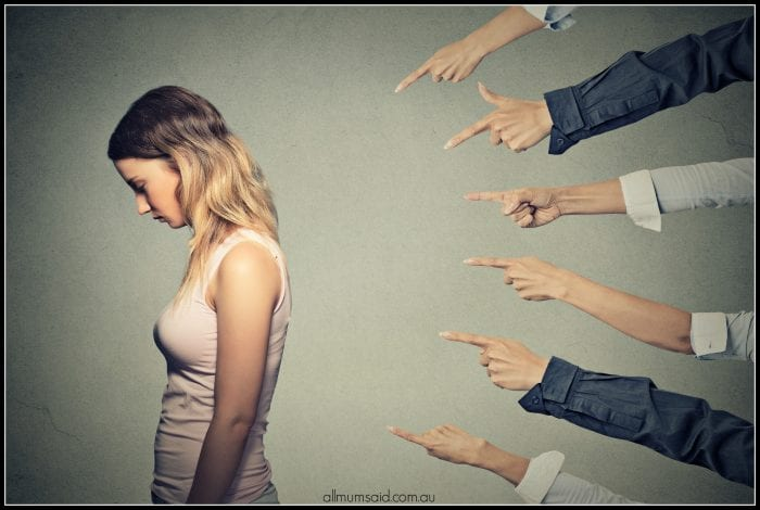online bullies pointing fingers at girl
