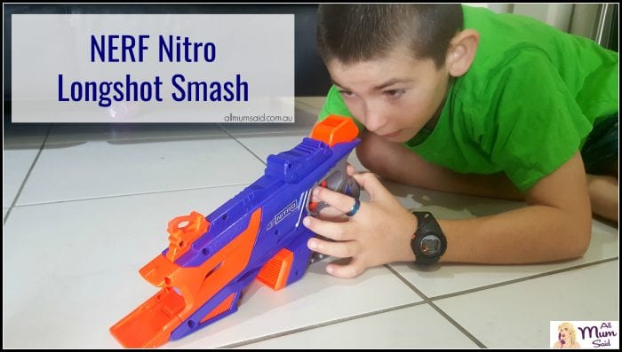 Boy playing with NERF Nitro longshot smash