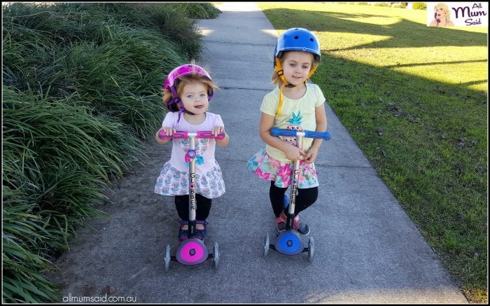 girls riding Globber scooters with flashing lights