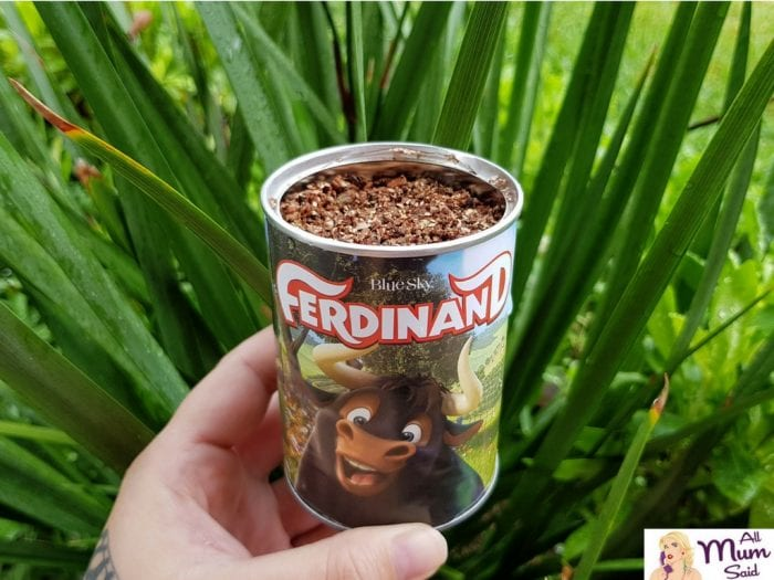 plant in a tin Ferdinand merchandise
