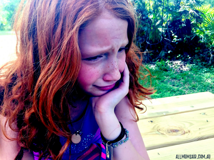 young girl crying and experiencing childhood disappointment