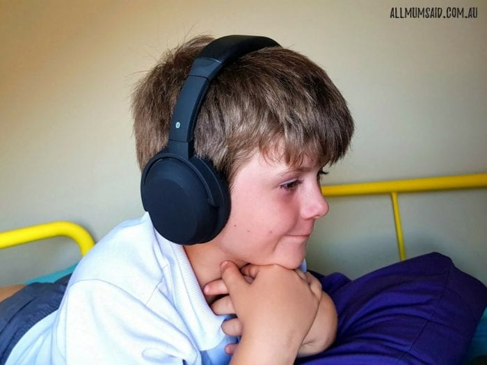 Boy wearing Laser bluetooth noise cancelling headphones