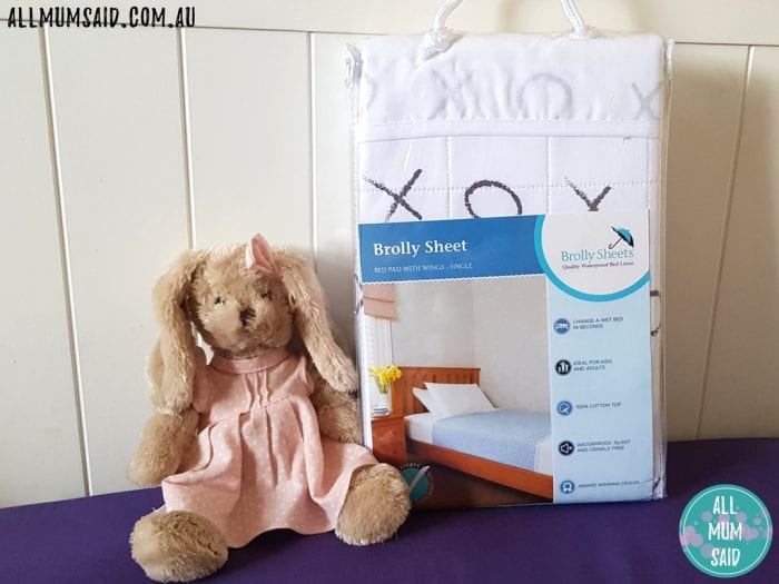 Brolly Sheets in pack on bed with plush bunny
