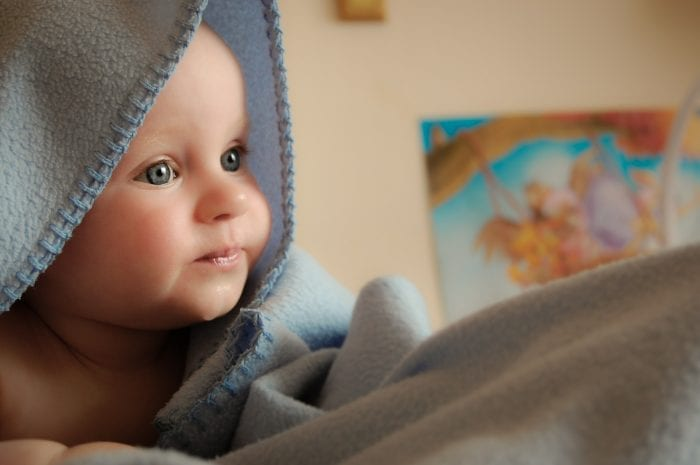 baby boy playing with blanket