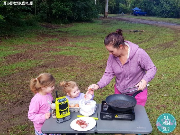 camping with kids cooking breakfast at campsite with ryobi radio