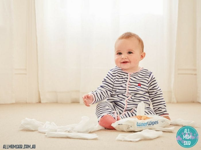 toddler playing with WaterWipes | premature babies needs