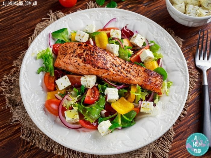 fried salmon on salad and feta