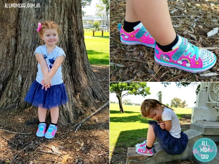 toddler playing in park wearing kids Skechers twinkle toes shoes