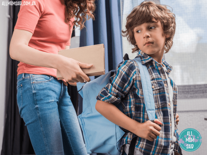 mum packing her sons backpack to stop kids losing things at school