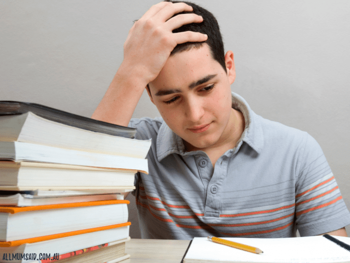teenager studying books concentrating // struggling in school