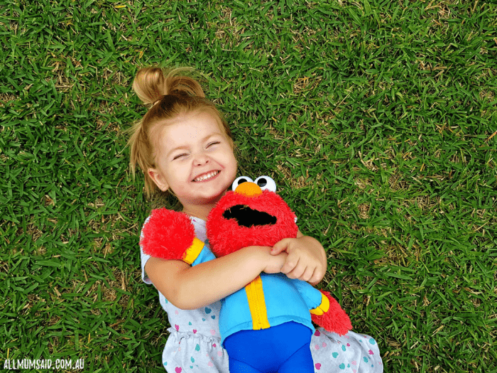 toddler playing with ready for school Elmo
