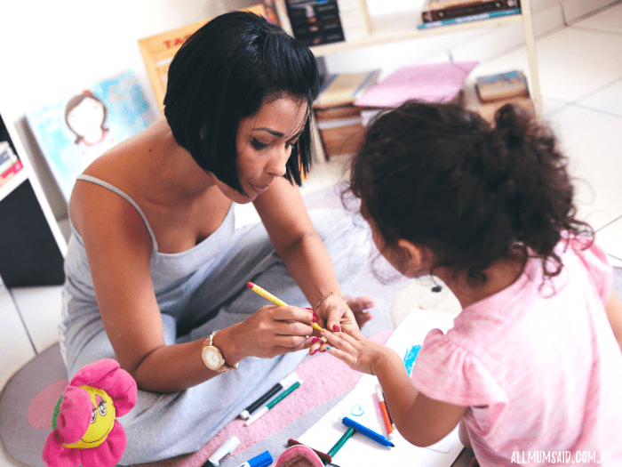 parenting styles - real mum painting childs finger nails with texta