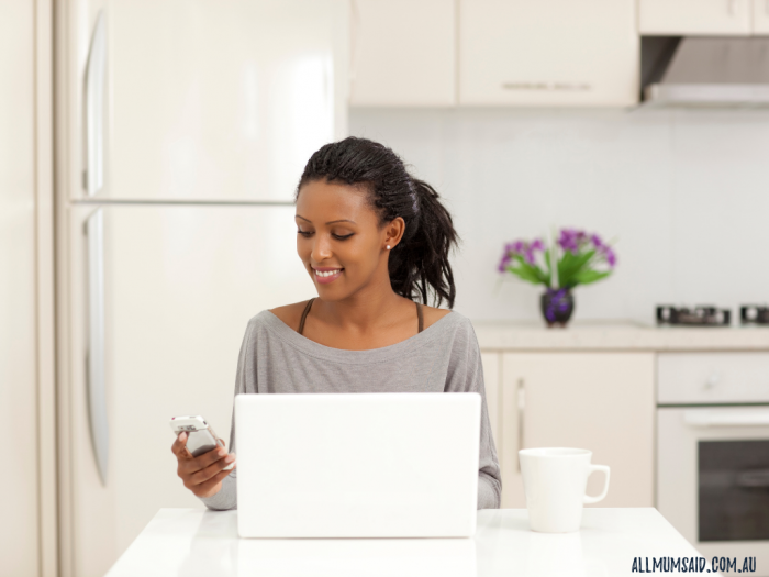 start a successful business - woman sitting at table with laptop and phone